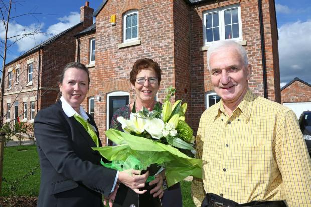 FIRST IN: Melanie Powls, of Mulberry Homes, with Charles and Joan Demaine, who have moved into the first house to be completed on the Sowerby Gateway estate, near Thirsk.