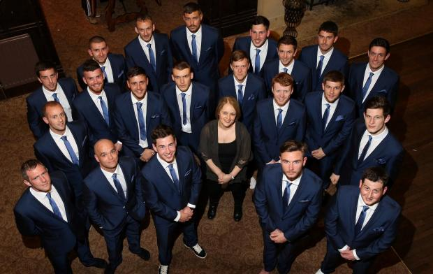 MATCH FIT: West Auckland players try on their FA Vase cup final suits. With the team is Ebac operations director Amanda Hird