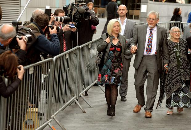 Rolf Harris, with his wife Alwen and daughter Bindi, left, arrives at Southwark Crown Court for the start of his trial for a string of alleged indecent assaults