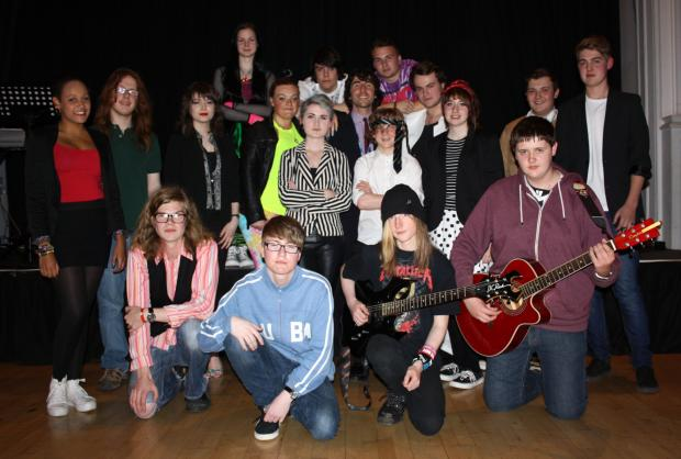 Elliot Smith, King James I director of music, centre, with pupils who performed a 1980s-style concert.