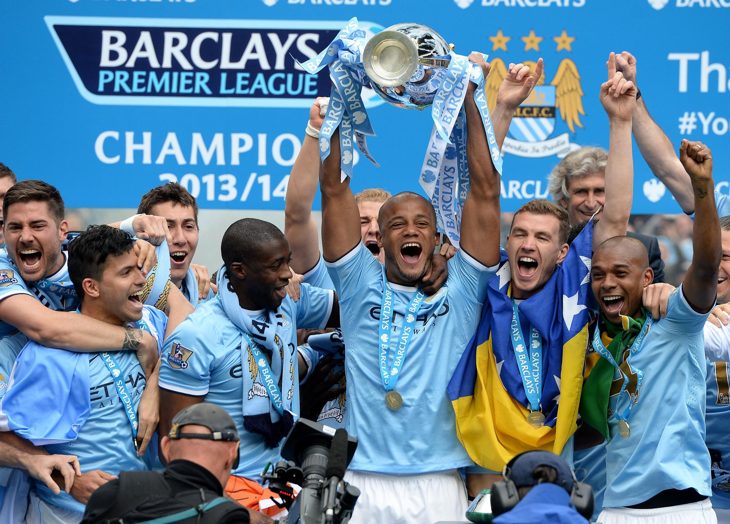 Manchester City captain Vincent Kompany leads the celebrations at the Etihad Stadium after his team won the Premier League title for the second time in three seasons. A comfortable 2-0 win over West Ham meant Liverpool's win over Newcastle didn't matt