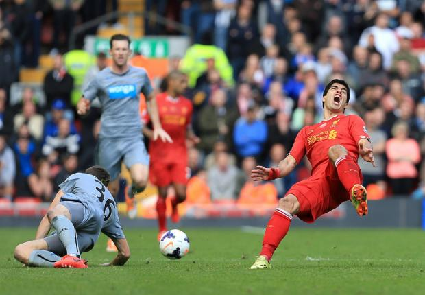 The Northern Echo: BAD CHALLENGE: Luis Suarez falls to the ground after a Paul Dummet tackle, which led to the Newcastle left-back being sent off