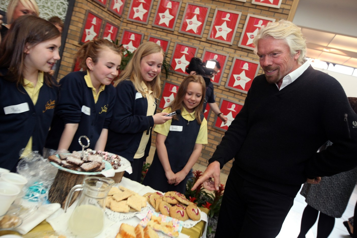 Sir Richard Branson meets pupils from West Jesmond Primary School in Newcastle taking part in Virgin Money's Fiver Challenge, which gives young entrepreneurs a chance to start their own business with a £5 loan. All profits are retained by the school.