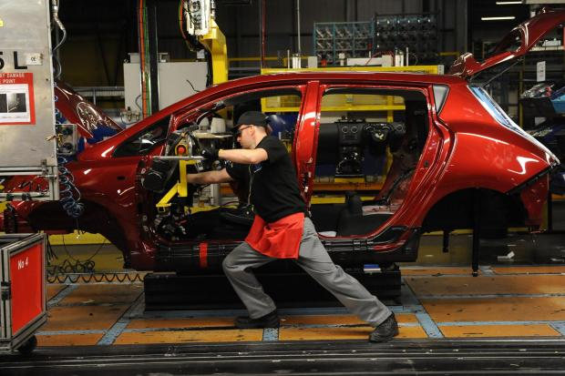 RELIABILITY STUDY: A Nissan worker fits the dashboard to an all-electric Leaf at the firm's Sunderland plant