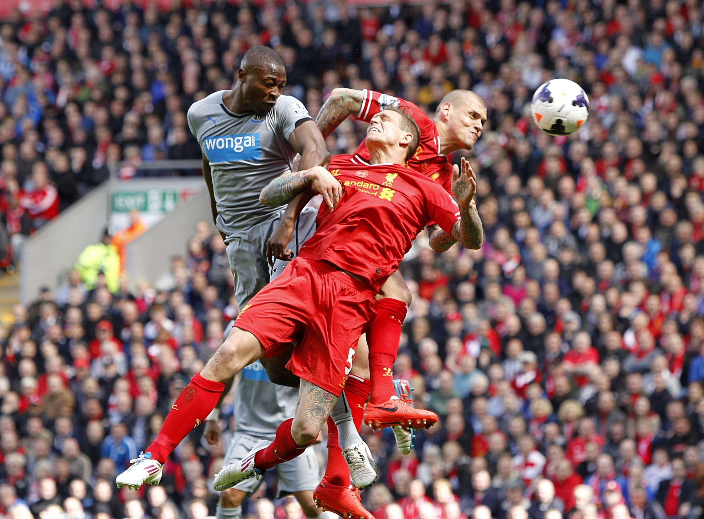 Anfield defeat: Newcastle striker Shola Ameobi battles for the ball with Liverpool's Daniel Agger and Martin Skrtel during the 2-1 defeat at Anfield on Sunday. PRESS ASSOCIATION Photo.