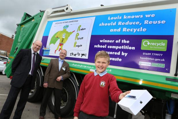Louis Flintoff with his i-Pad and winning design on the side of a recycling collection vehicle, with Yorwaste managing director Steve Grieve (left) and Councillor Brian Phillips (right) in the background.