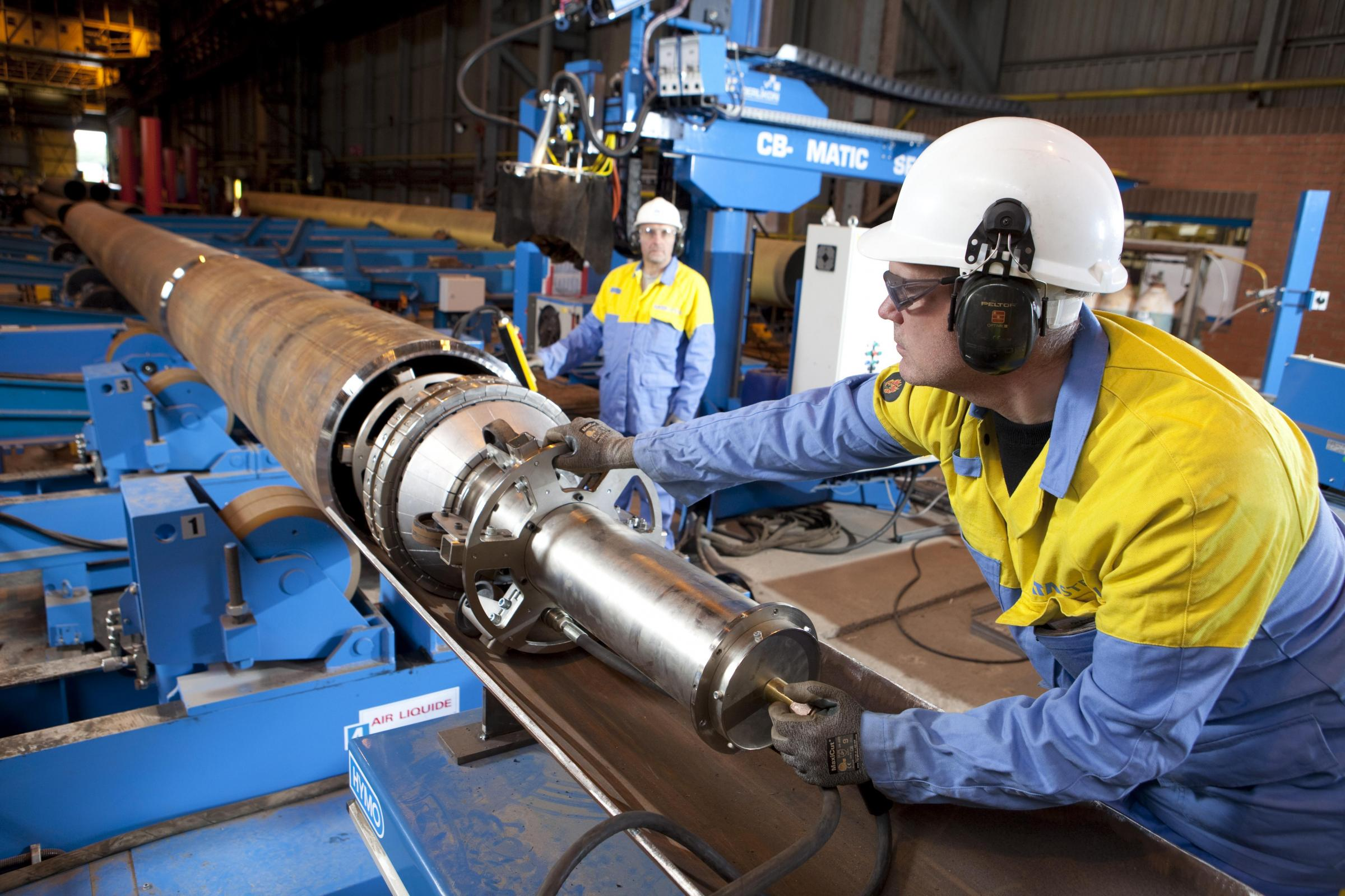 Workers operate machinery at Tata Steel's Hartlepool pipe mill