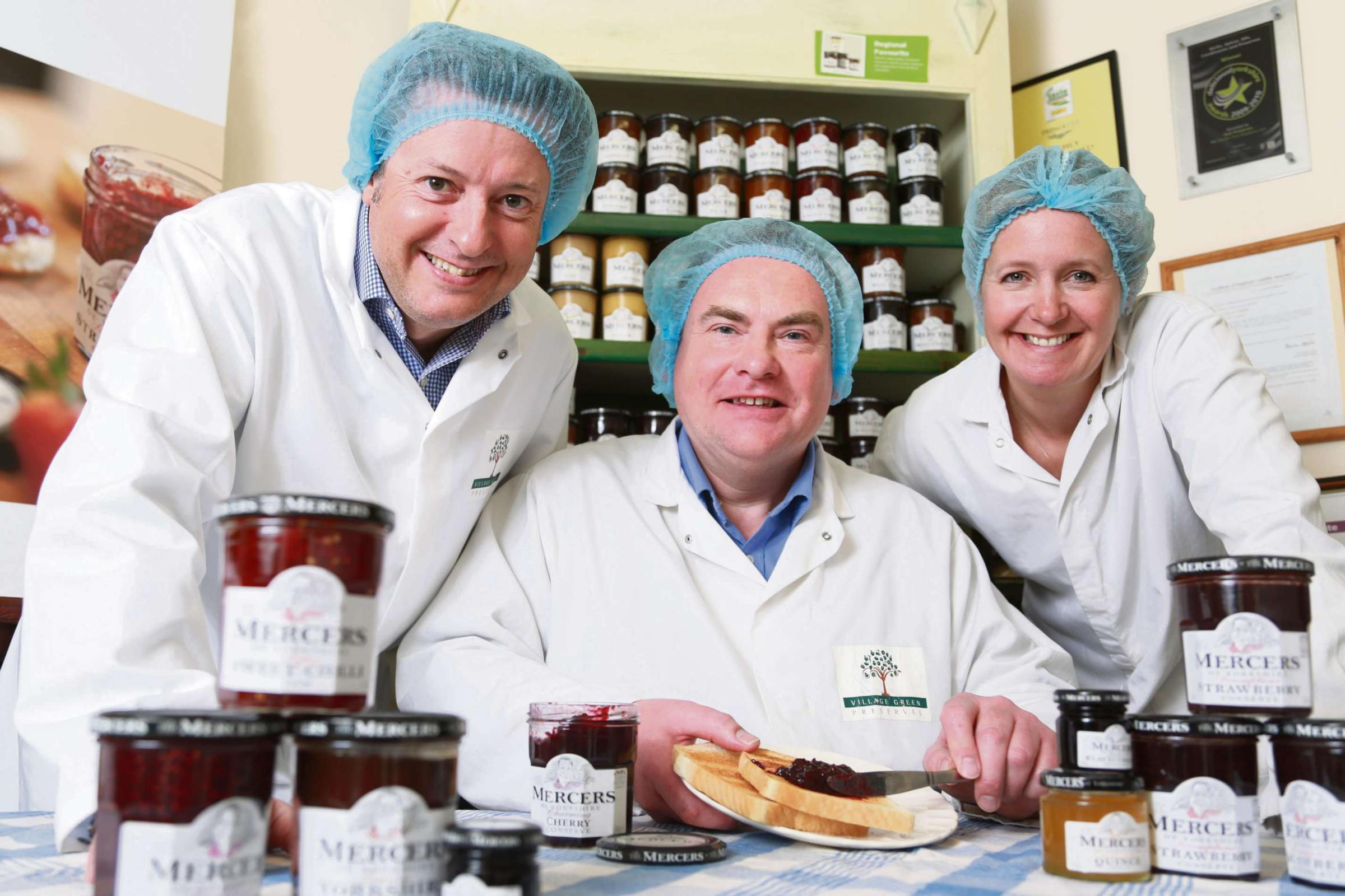 SERVING SUCCESS: Andrew Nicholson, centre, with Paul and Lizzie Mercer, from York Speciality Foods