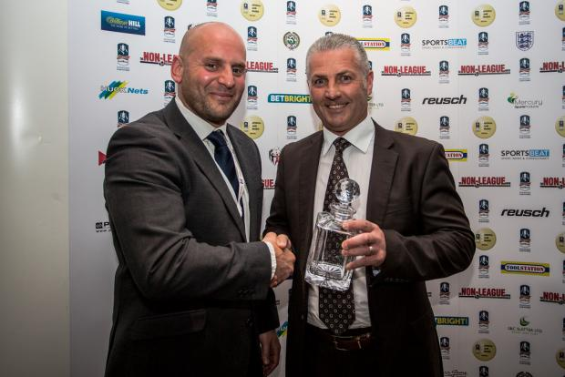 Gateshead boss Gary Mills, right, receives his S&C Slatter Manager of the Year award
