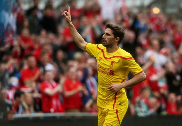 The Northern Echo: Goal-getter: Liverpool's Fabio Borini celebrates scoring at the Aviva Stadium on Wednesday after returning from a Sunderland loan