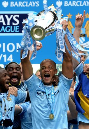 JUST CHAMPION: Vincent Kompany lifts the Premier League trophy above his head after Manchester City finished two points clear of their rivals