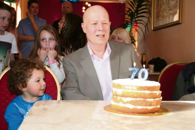 HAPPY BIRTHDAY: Prof Hildreth blows out his candles watched by son Max