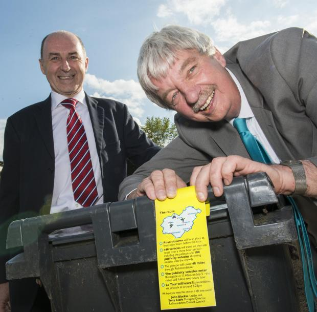 BIN TAGS: Richmondshire District Council director Tony Clark and leader Coun John Blackie show off Tour de France information bin tags
