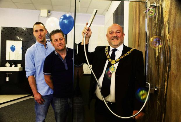 New bathroom business Simply Bathrooms bucks the trend to open in Bishop Auckland town centre, pictured are owners Mark Gilchrist and Wayne Marley with Mayor David Fleming.