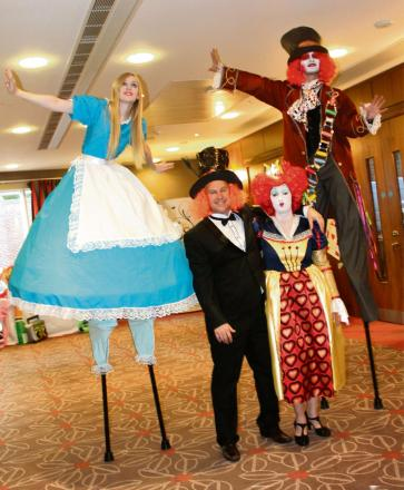 HIGH TOTAL: Stilt walkers helped raise more than £8,000 for charity