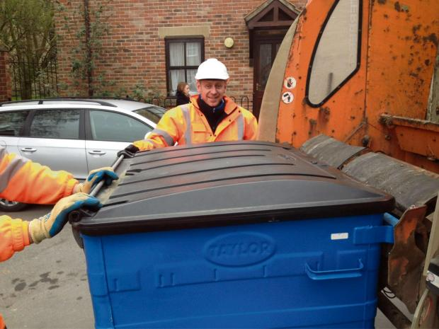 Mr Abell joins a bin crew at work.