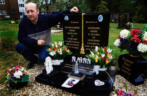 DEVASTATED: Maurice Crang visits his parents' grave in Darlington's East Cemetery where thieves have stolen flowers that were left on their grave. Picture: SARAH CALDECOTT