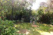 The back garden of the house where the previous owners are buried