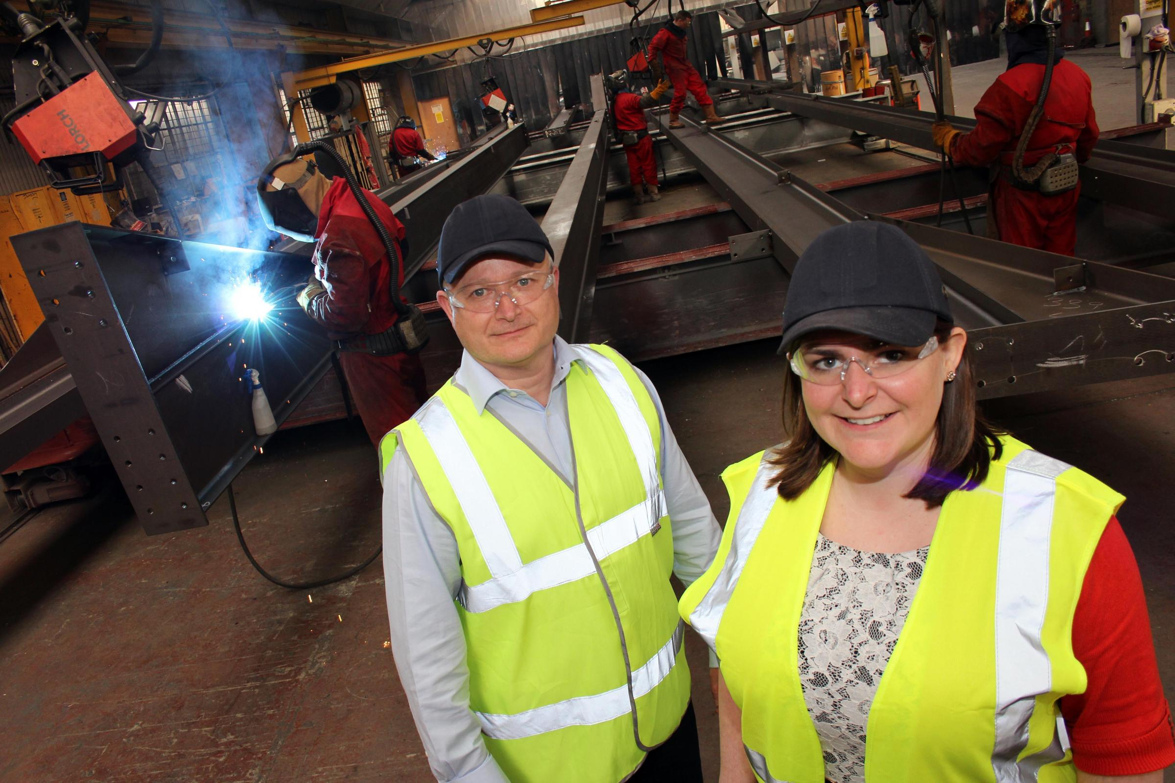 STRONG TEAM: Finley Structures' new senior quantity surveyor Diane Ruston with operations manager Jim Graham. They are pictured in the company's plant as staff work on steel for Hitachi Rail Europe's Newton Aycliffe £82m factory