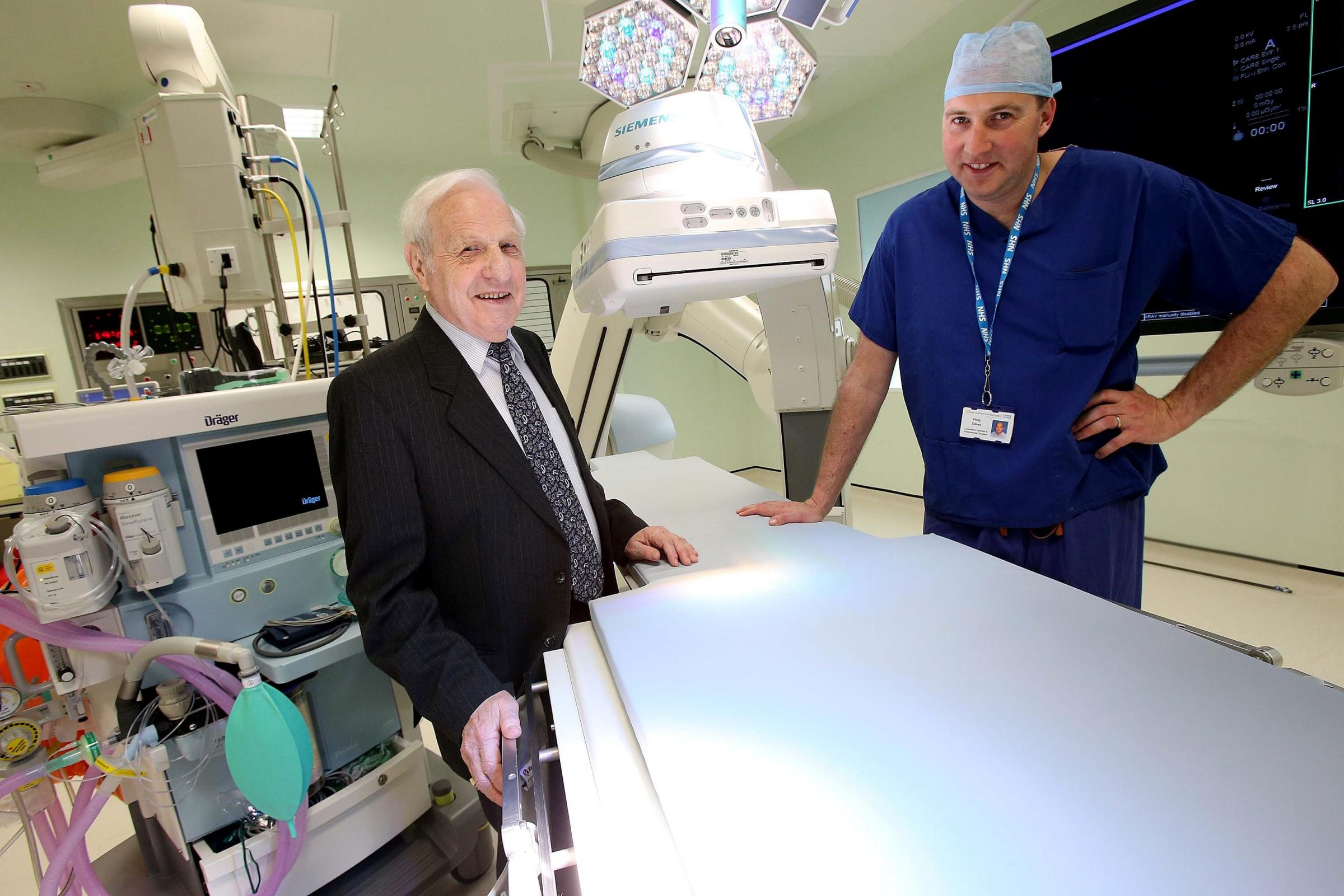 REGION'S FIRST: Surgeon Philip Davey with 81 year old Dennis Moody in the new endovascular hybrid theatre at the University Hospital of North Durham. Picture: DAVID WOOD