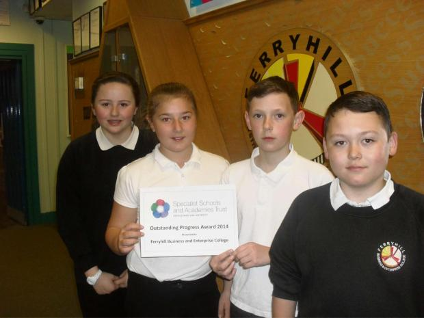 SCHOOL PRIDE: Year eight pupils Holly Williams, 13, Ellie Hewitson, 12, Adam Smith, 13, and Kai Flatman, 12, with the award