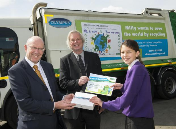 PICTURE WINNER: Milly Wood-Weatherill receives her iPad from Yorwaste director Steve Grieve (left) and a certificate from Councillor Clive World.