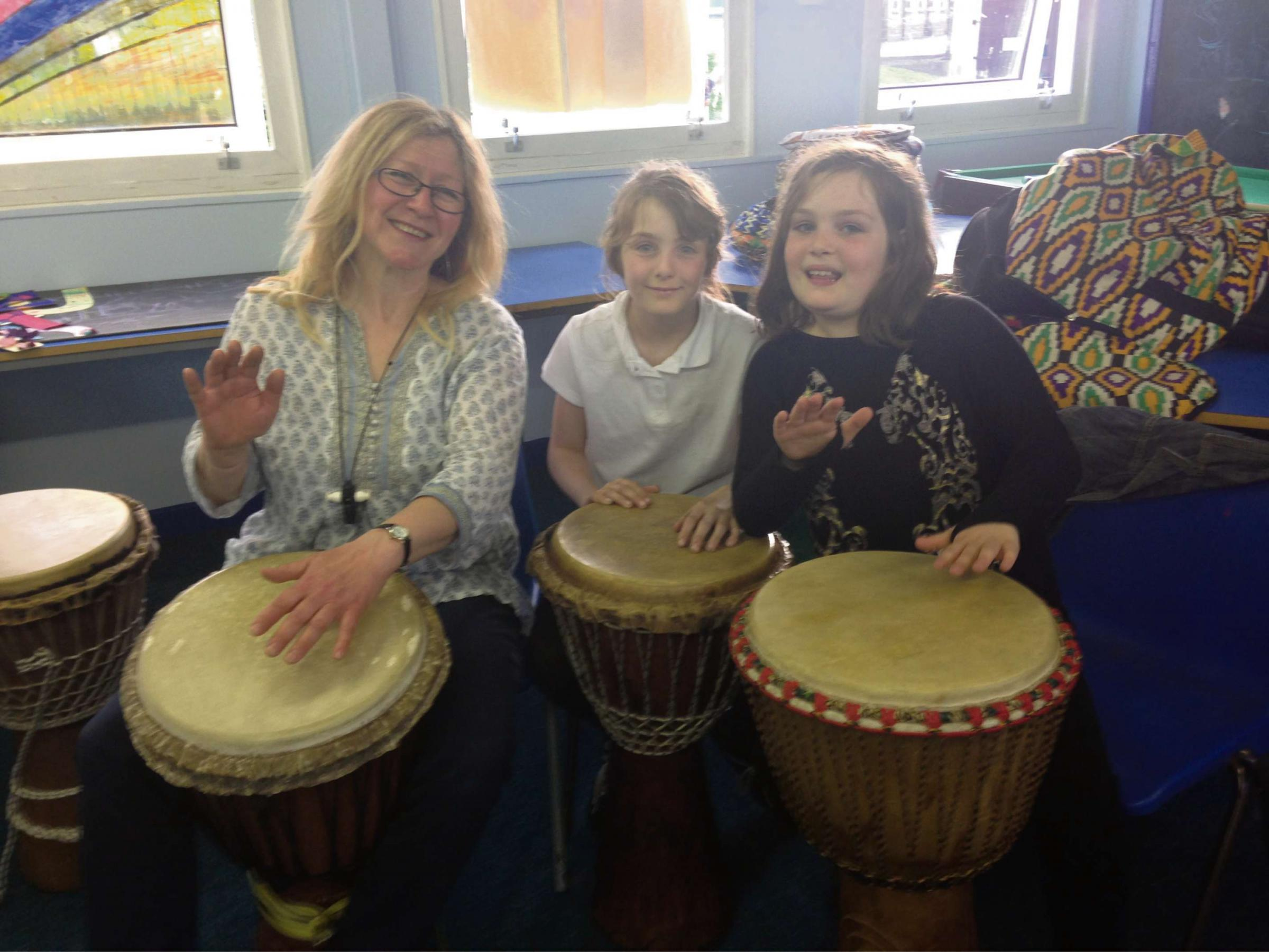 DRUM TIME: Alison Lyon from Drums Agogo with, Katie Durkin,11, and Nadine Crowther, 9.