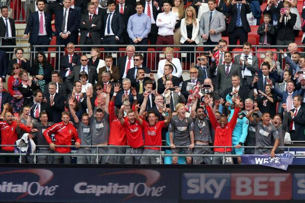 Promotion party: Middlesbrough's Richie Smallwood, third from left, celebrates at Wembley after Rotherham United's League One play-off final success on Sunday