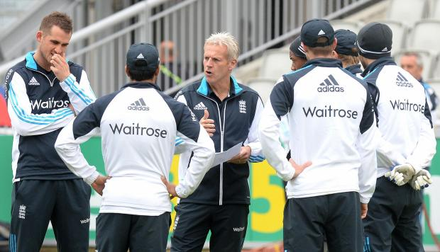 TIME TO RESPOND: England head coach Peter Moores talks with his players ahead of today's ODI with Sri Lanka at Old Trafford