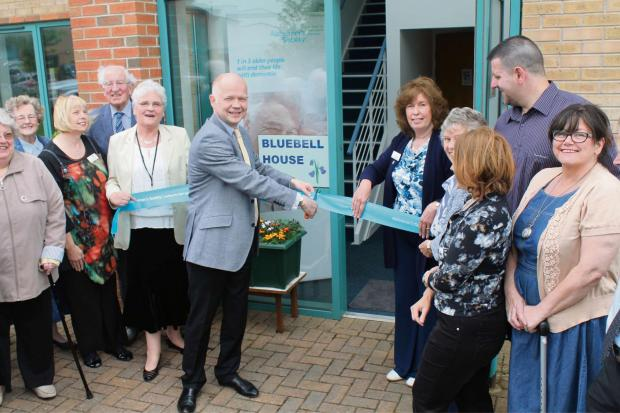 CENTRE OPENS:  William Hague along with services manager Pam Crawford, on right, and day support manager Sheila Smith, on left, are joined at the opening by users, staff and volunteers.