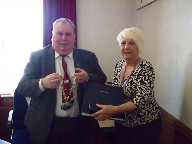CHAINS CHANGE HANDS: Coun Ken Campbell hands Ferryhill mayoral chains to Coun Pauline Crathorne