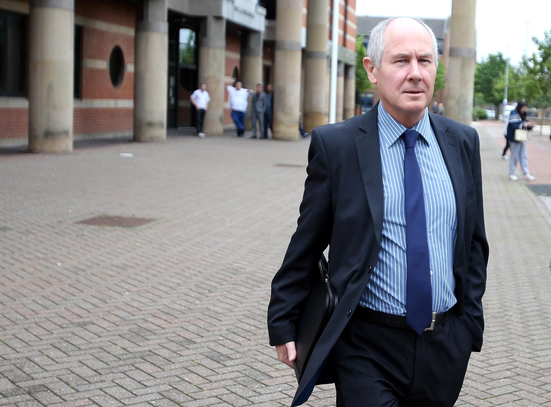 John Darwin leaves Teesside Crown Court after the hearing today