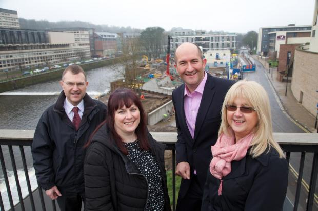 RIVERSIDE RENEWAL: left to right Steve Gray (NS&I), Carole Soulsby (NS&I), Neil McMillan (Carillion Developments) and Janine Bonnick (HMPO) overlooking the development at Freeman's Reach.