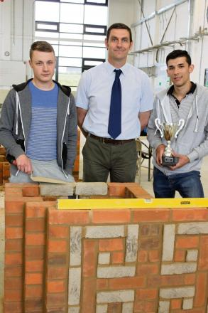 BRICKLAYING SUCCESS: Nathan Cooper, left,  and David Wood with their lecturer at Bishop Auckland College Chris Lee, centre