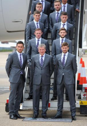 ENGLAND'S PRIDE: Roy Hodgson, flanked by Frank Lampard and Steven Gerrard, are pictured with the rest of the World Cup squad before they flew out of Luton Airport for Miami yesterday afternoon