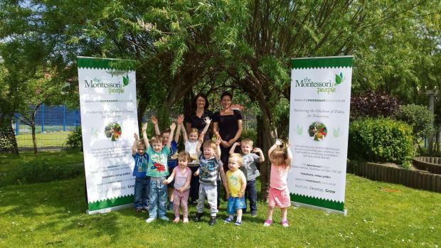 Pictured (L-to-R):  Angela Stanton and Michelle Tudor,  members of staff atThe Montessori People nursery at Stockton  with some of  the children they look after