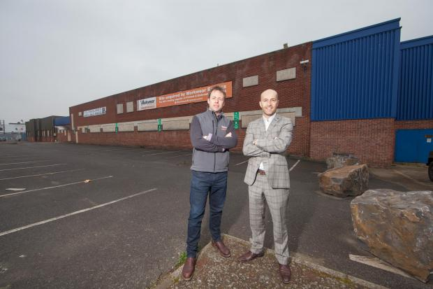 STRONG GROWTH: The purchase of the former Kerry Foods factory by entrepreneur Andrew Ward helped to fuel growth at Bradley Hall. Mr Ward, left, is pictured at the site with Bradley Hall director Peter Bartley