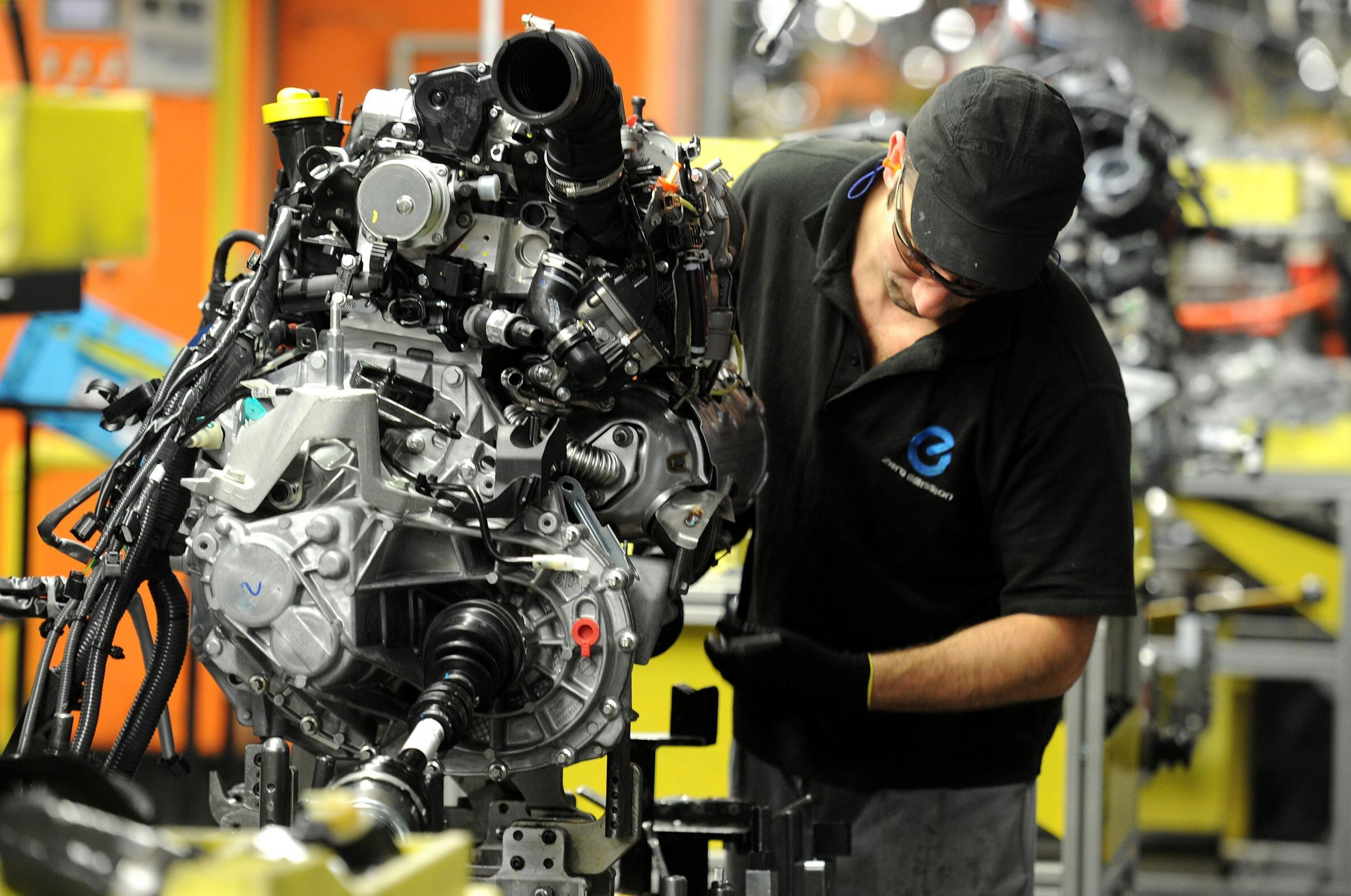 SALES RISE: A Nissan employee works on components for a Qashqai model