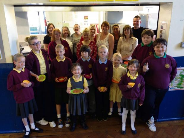 BREAKFAST CLUB: Pupils at Stanley Crook enjoy breakfast served by volunteers, school staff and Greggs employees