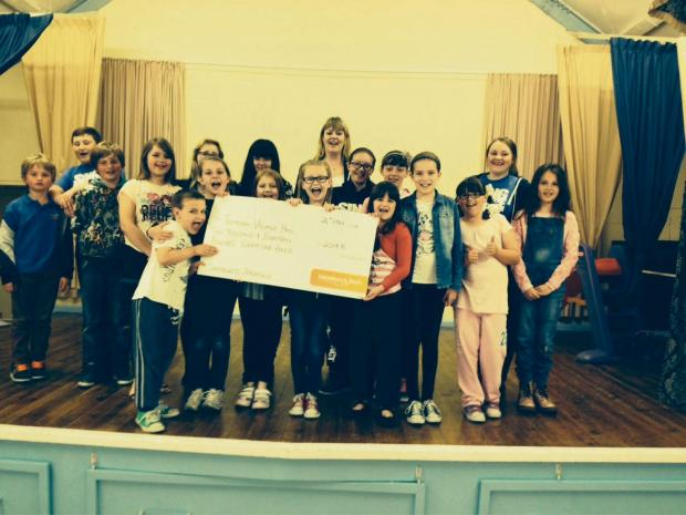 Victoria Tiffin, PR ambassador for Sainsbury's, presents the cheque to youngsters at Trimdon Village Hall