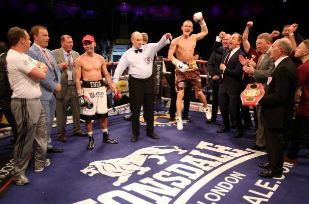 IT'S OVER: Stuart Hall, left, shows his dejection as a delighted Paul Butler leaps into the air having won the IBF world bantamweight title on a split point decision