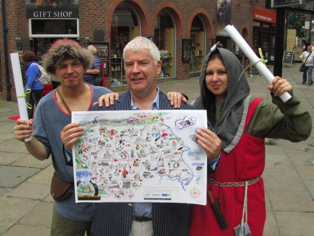 TOUR MAP: Artist Tim Bulmer (centre) with the map, is joined by Vikings Bork (left) and Dilla (right)
