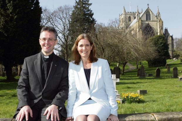 NEW ROLE: Canon John Dobson, with wife Nicola outside Ripon Cathedral