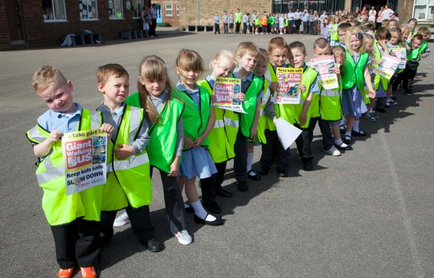 ROAD SAFETY: Pupils took part in a countrywide giant walking bus initiative. PICTURE Keith Taylor