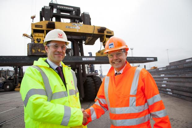 NEW DELIVERY: Cornelius Louwrens, SSI UK business director and chief operating officer, with PD Ports' Jerry Hopkinson as steel slab is exported through Teesport