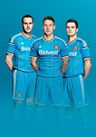 FEELING BLUE: Sunderland AFC have unveiled its new away kit for the 2014-15 Barclays Premier League season, which will launch on Friday, June 27. John O'Shea, Connor Wickham and Adam Johnson are pictured modelling the new kit