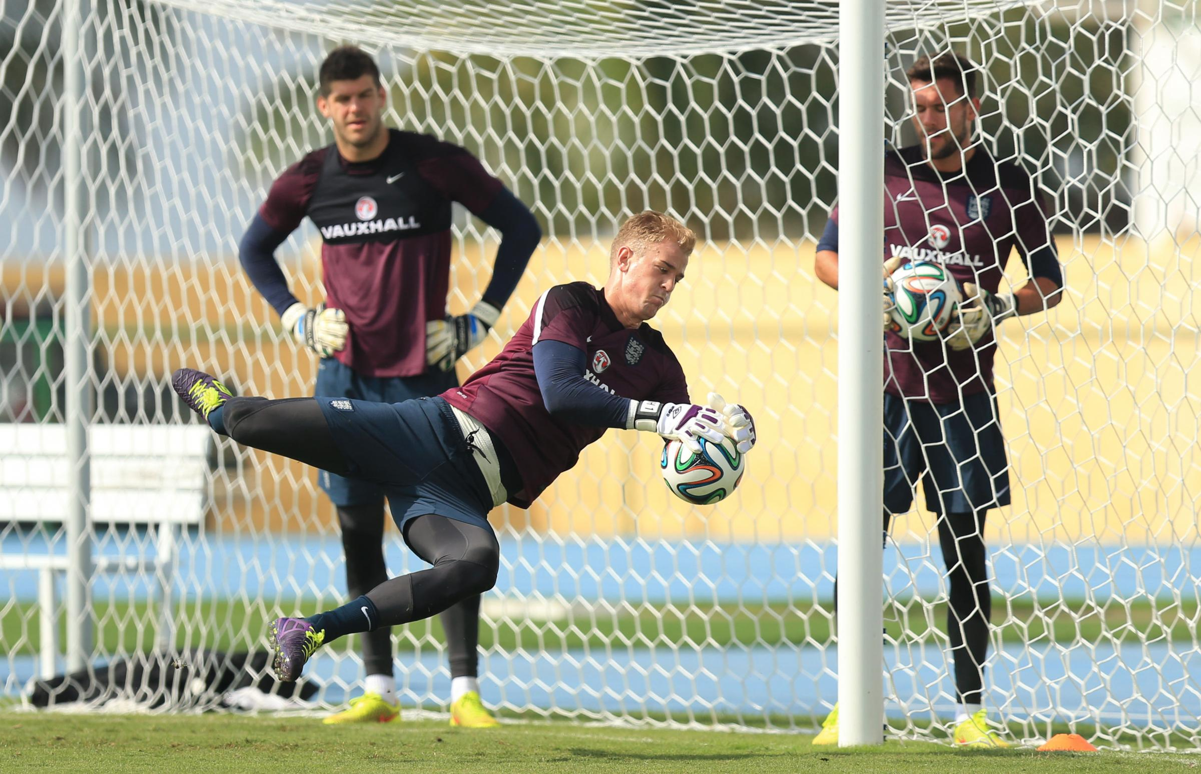 SAFE HANDS: Joe Hart is closely watched by Fraser Forster and Ben Foster in training