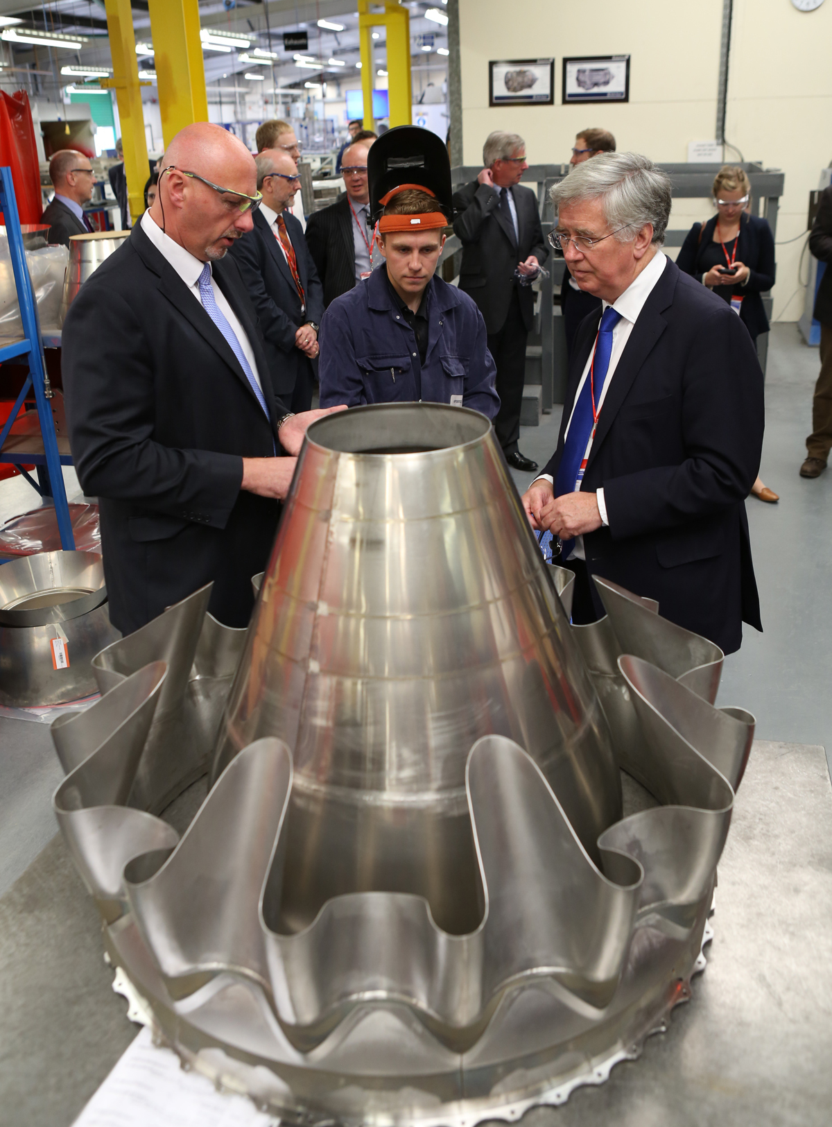 FACTORY EXPANSION: Billy Meijer, Darchem managing director, left, talks to apprentice James Kenny and Energy Minister Michael Fallon about an Aro engine mixer