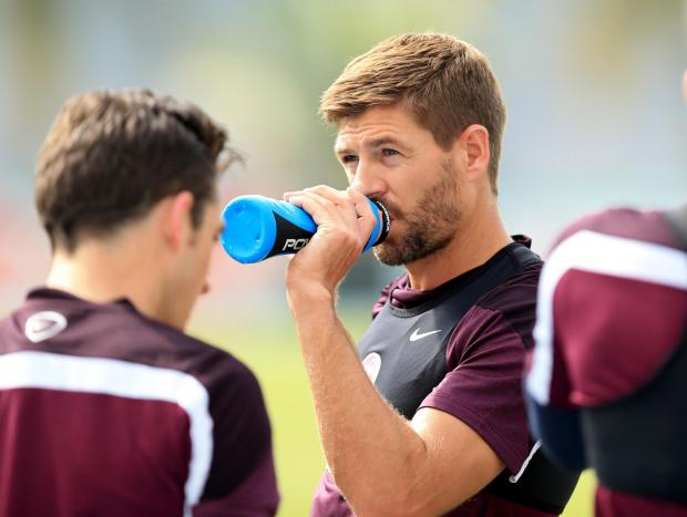 THIRSTY WORK: England captain Steven Gerrard stops to have a drink during a training session ahead of tonight's World Cup opener against Italy Picture: MIKE EGERTON/PA