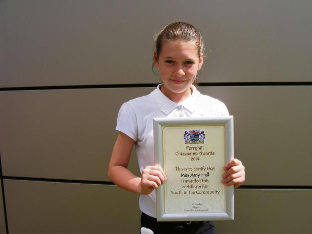 Teenager Amy Hall who has won a bravery award for caring for her badly injured mother